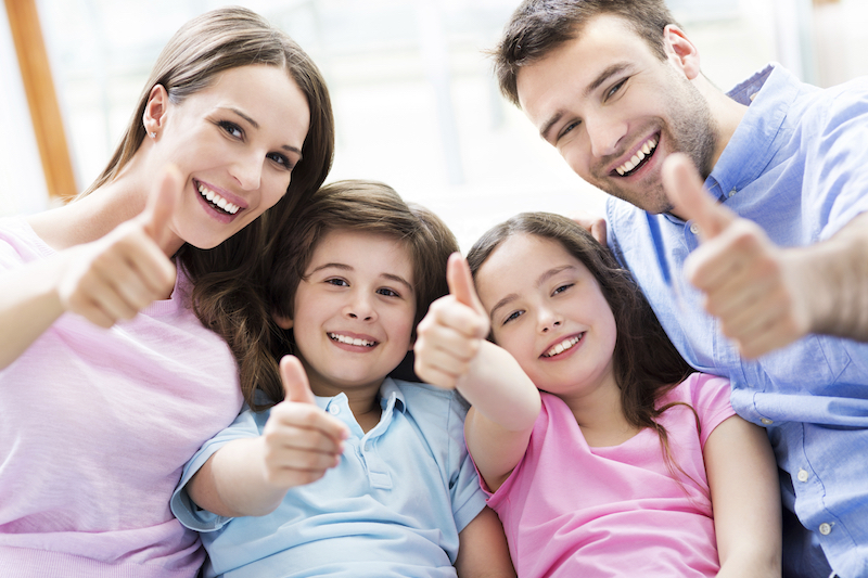 family satisfied with their air conditioner service